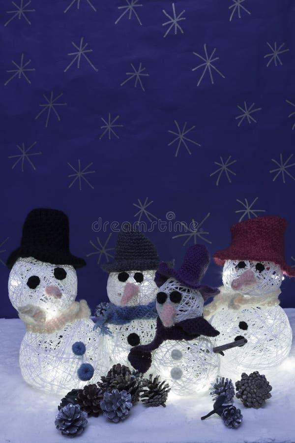 Xmas decorations crafts snow scenary, illuminated snowmen stock photos