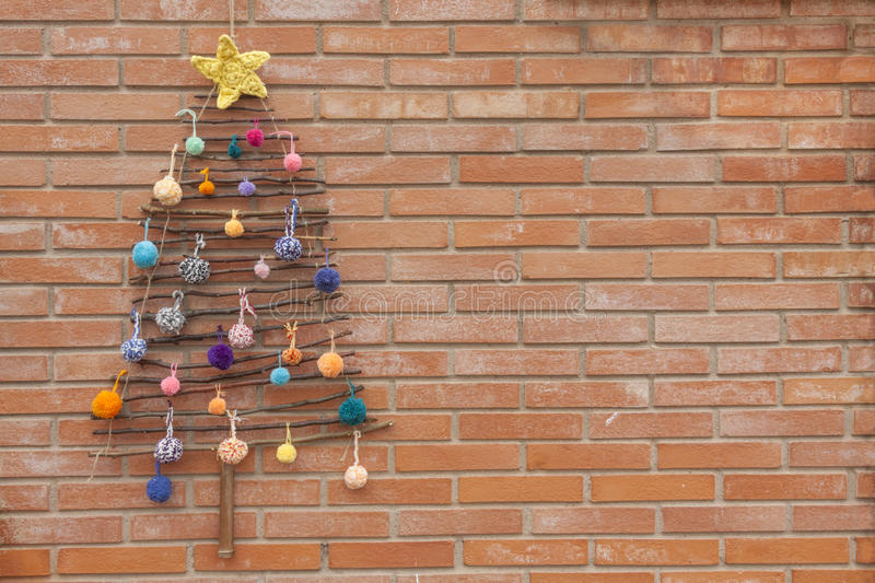Xmas decorations crafts tree wall pompom royalty free stock photo
