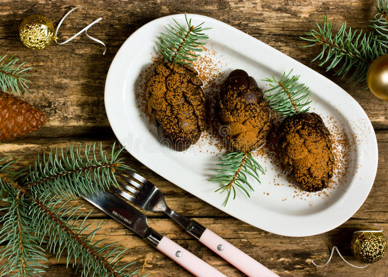 Xmas dessert in a pinecone form. On a wooden background royalty free stock image