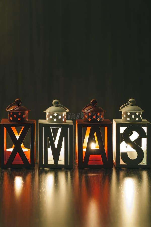 Xmas-garnering med stearinljuslyktor royaltyfria bilder