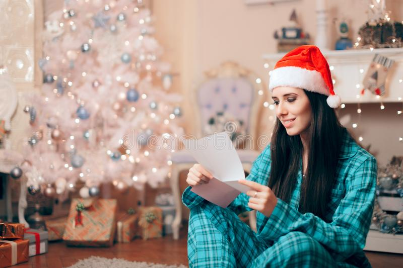 Woman Reading Love Letter under the Christmas Tree royalty free stock photos
