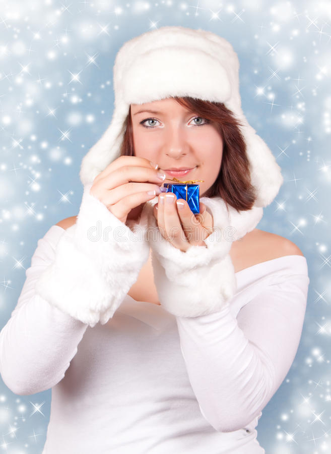Download Xmas Girl Opening A Gift With Snowflakes Stock Photo - Image: 12201896