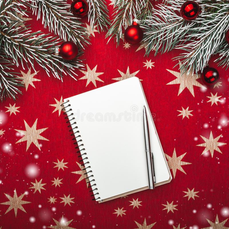 Xmas greeting card, notebook, for Santa`s letter. Fir branches with Christmas balls. Top view. Snow effect royalty free stock image