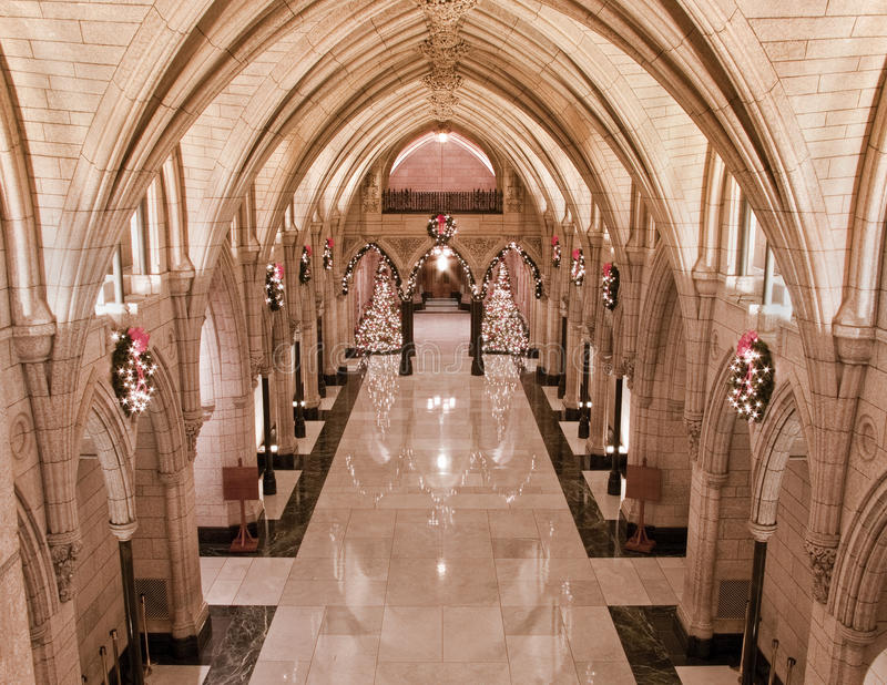 Xmas Honour Hall. The Canadian Parliament Hall of Honour decorated for Chritmas with trees and wreaths royalty free stock photos