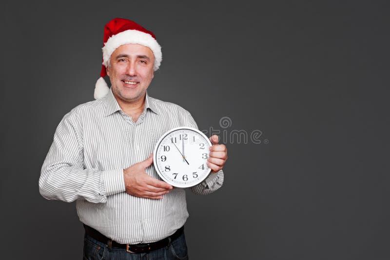 Download Xmas man showing the clock stock image. Image of celebration - 28132101