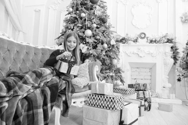 Xmas online shopping. Family holiday. Happy new year. Winter. The morning before Xmas. New 2019 Year is coming. small. Girl. Christmas tree and presents. Child royalty free stock photography