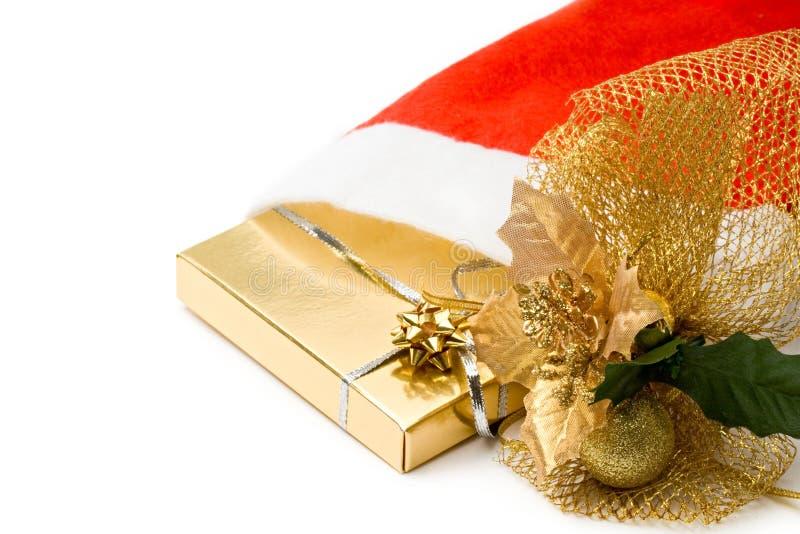 Xmas presents. In santa's hat stock image
