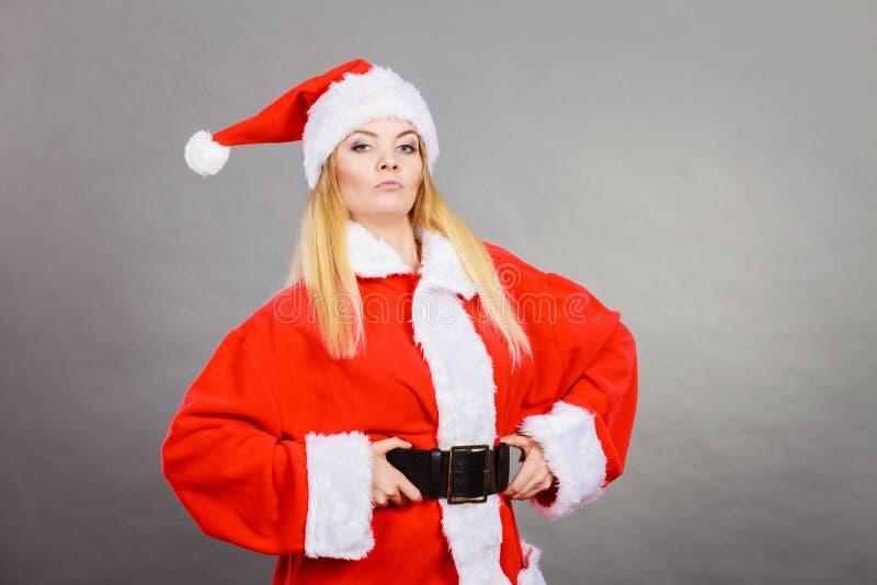 Confident woman wearing Santa Claus helper costume stock image