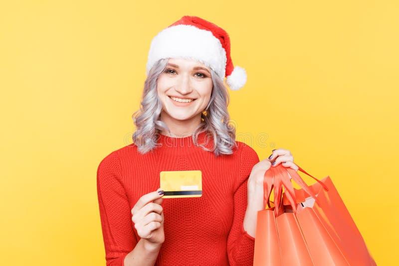 Xmas shopping online concept. Christmas girl holding credit card and big bags. Xmas shopping online concept. Christmas girl holding credit card and big bags royalty free stock photos