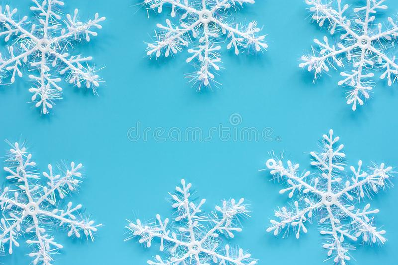Xmas snowflake ornaments and decoration on blue background. For Christmas day and holidays concept stock photo