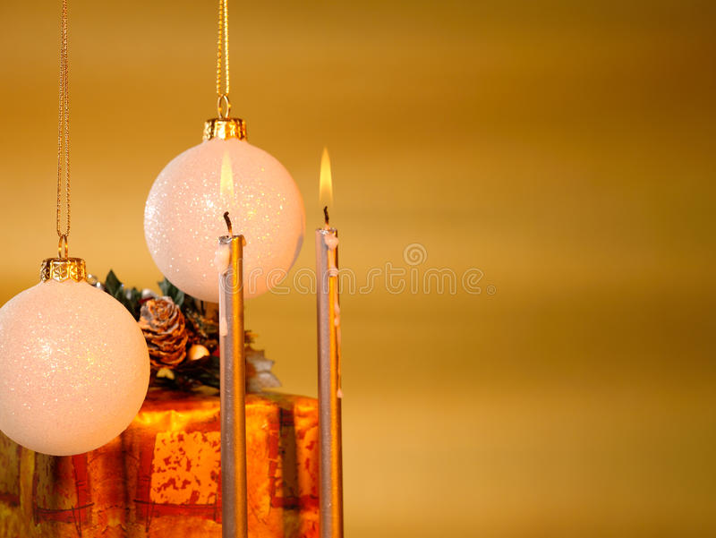 Xmas still-life with candles. And christmas balls stock image