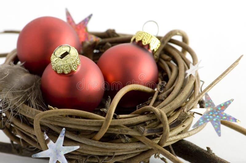 Xmas theme. Xmas balls, nest, isolated on a white background royalty free stock image