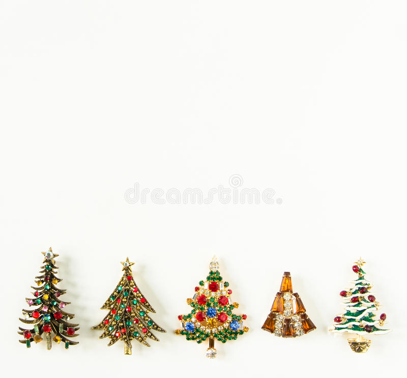 Free Xmas Theme. Woman Jewelry. Vintage Jewelry Background. Beautiful Bright Rhinestone Christmas Tree Brooches On White Background. Royalty Free Stock Image - 95838176