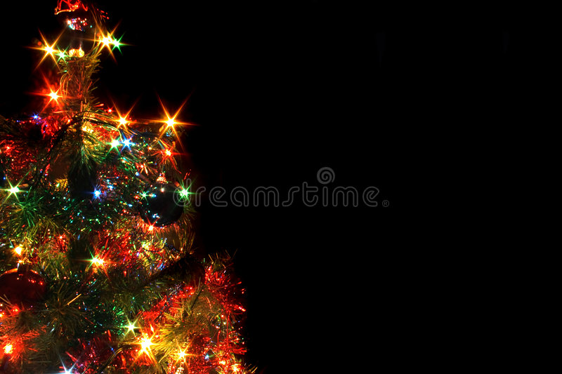 Xmas tree. With many colored lights on the black backgorund royalty free stock image