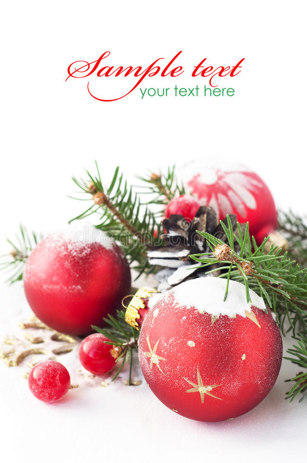 Xmas tree and baubles on the snow royalty free stock photos