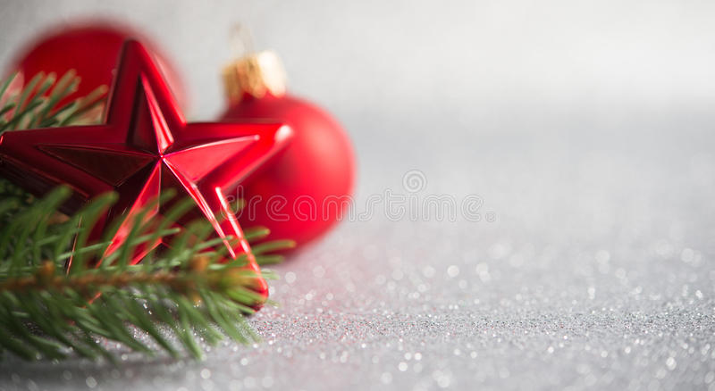Xmas tree and red ornaments on glitter holiday background. Merry christmas card. Winter theme. Happy New Year. Space for text stock photos
