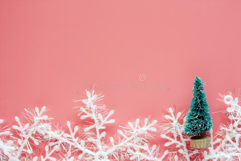 Xmas tree with snowflake ornaments and decoration on pink background. For Christmas day and holidays concept stock image