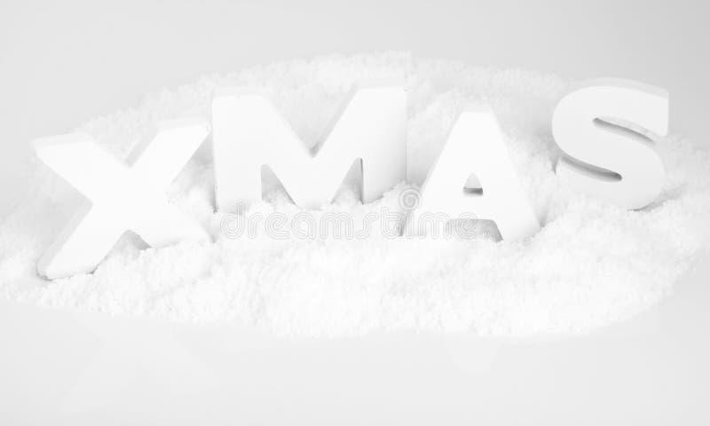 XMAS vita träbokstäver i snowen arkivfoto