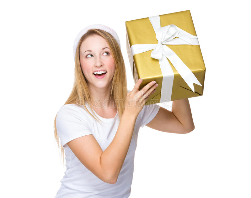 Xmas woman guess the present in box. Isolated on white background royalty free stock image