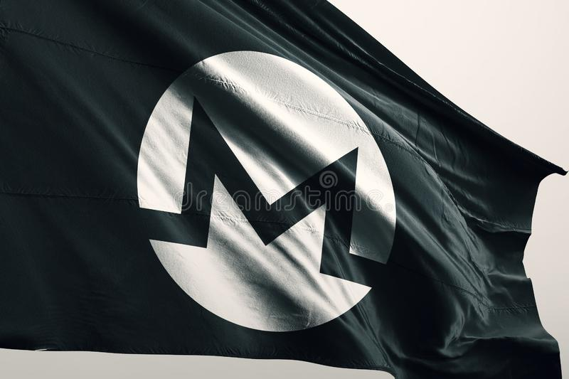 XMR Monero photorealistic flag in wind. Monero is an open-source cryptocurrency created in April 2014 that focuses on fungibility, privacy and decentralization royalty free stock photography