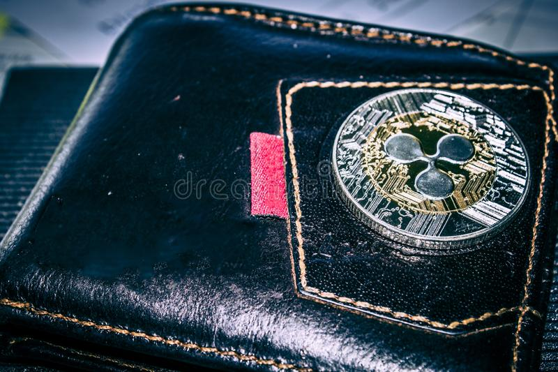 Xrp cryptocurrency coin on leather wallet. Ripple cryptocurrency coin on leather wallet royalty free stock photography