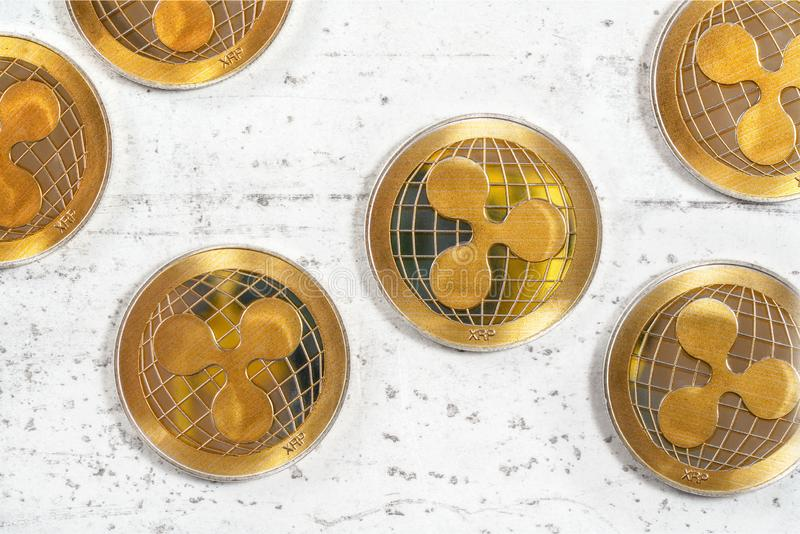 XRP ripple cryptocurrency golden coins on white stone like board, flat lay view from above.  royalty free stock photography