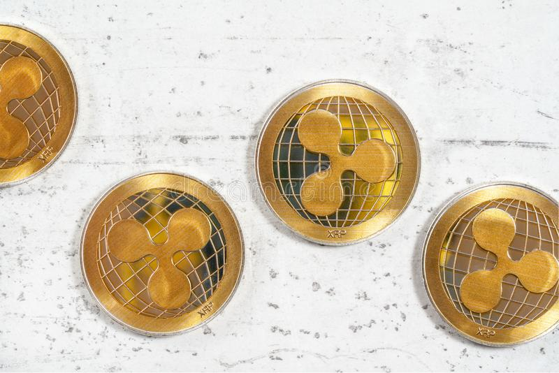 XRP ripple cryptocurrency  golden coins on white stone like board, photographed from above. XRP ripple cryptocurrency golden coins on white stone like board stock photos