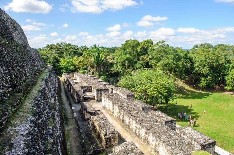 Xunantunich Mayan Ruin in Belize. XUNANTUNICH, BELIZE - January 04, 2012: Tourists learn about the ancient Mayan pyramid on January 04, 2012 in Xunantunich stock photos