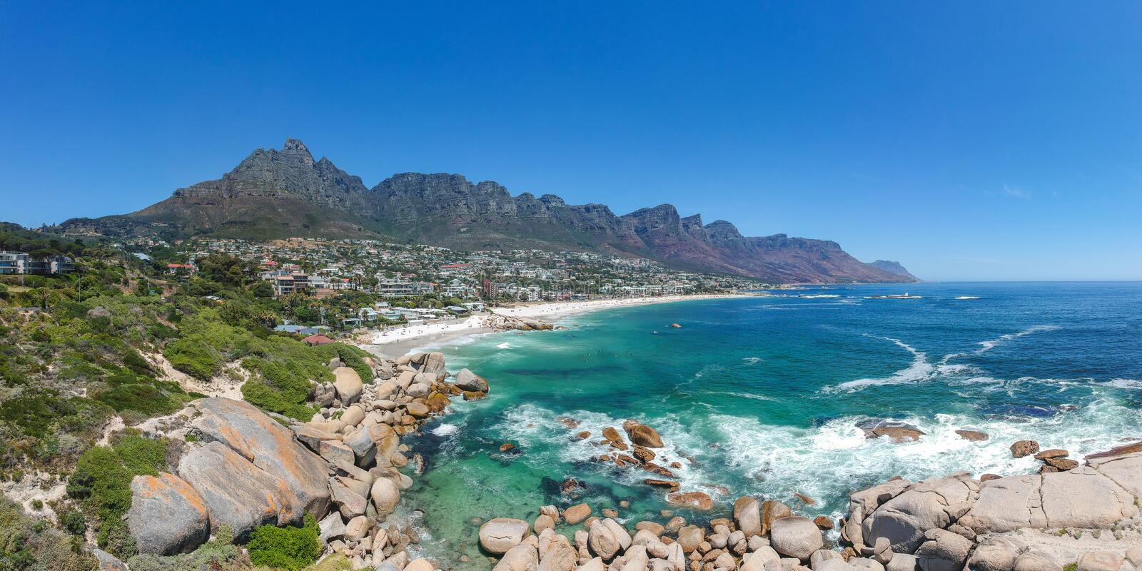 XXL aerial panoramic drone view of Camps Bay, an affluent suburb of Cape Town, South Africa. royalty free stock photos