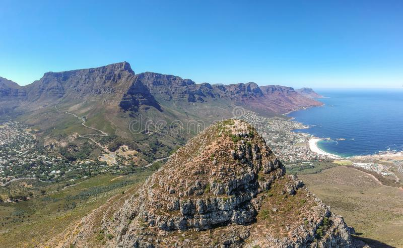 XXL panoramic wide angle aerial drone view of the summit of Lion`s Head mountain and Table Mountain. royalty free stock photos
