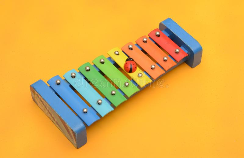 Xylophone children music playing ornament yellow background.  stock images