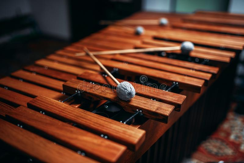Xylophone closeup, wooden percussion instrument. Xylophone with sticks closeup, nobody, wooden percussion instrument, vibraphone stock photography