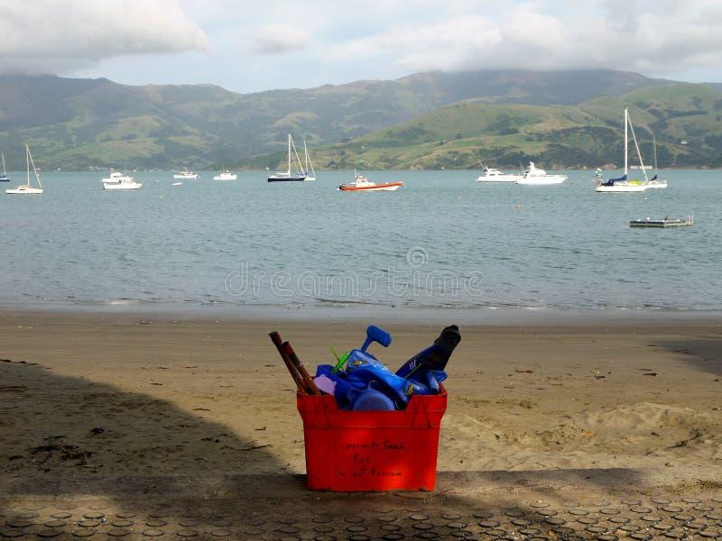 New Zealand: Akaroa harbour beach with community equipment royalty free stock photo