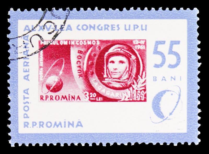 Y Gagarin stämpel MiNr RO 1964 och jordklot med omloppet, stämpeldagserie, circa 1963 royaltyfria foton