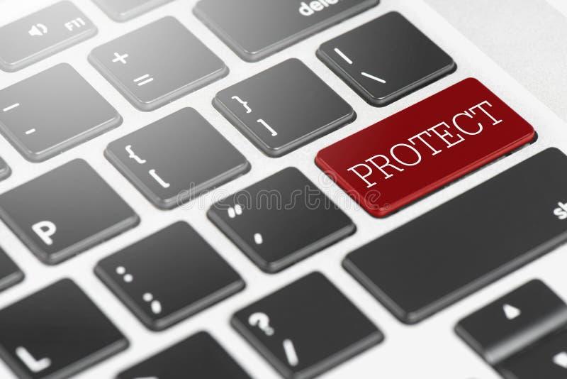 y x22; PROTECT& x22; Teclado del botón rojo en el ordenador portátil para el concepto del negocio y de la tecnología foto de archivo