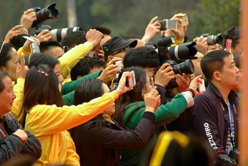 Yaan China-Some peoples eagerly snapping photos. In front of the stage of the Tea Expo in Mingshan,some peoples eagerly snapping photos.Yaan China-Danchayuan royalty free stock photography