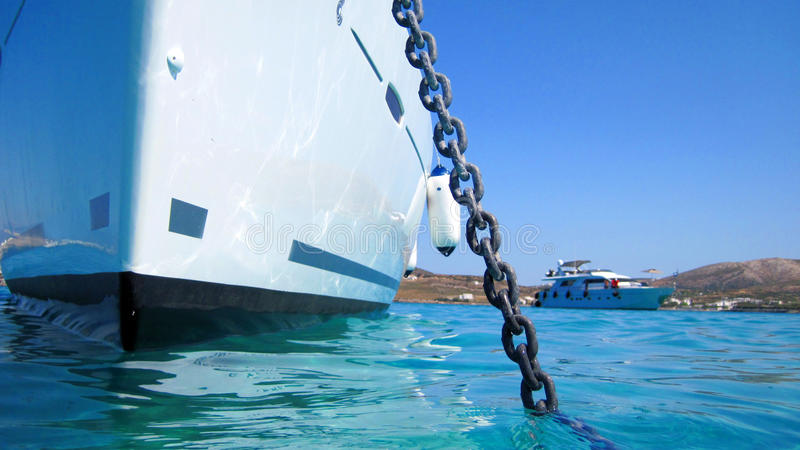 Yacht anchored in harbor. Bow of yacht or luxury boat anchored in a harbour stock photography