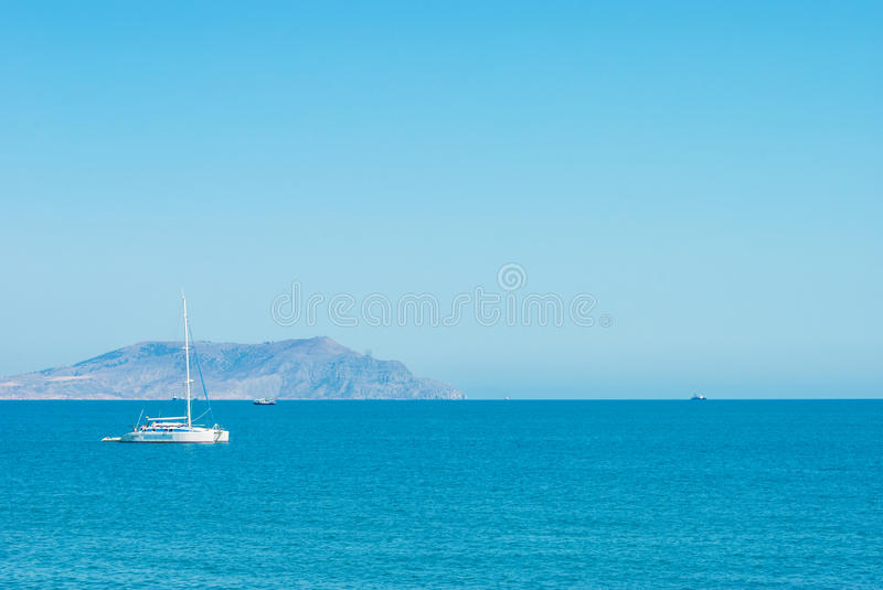 Yacht in the bay royalty free stock photo