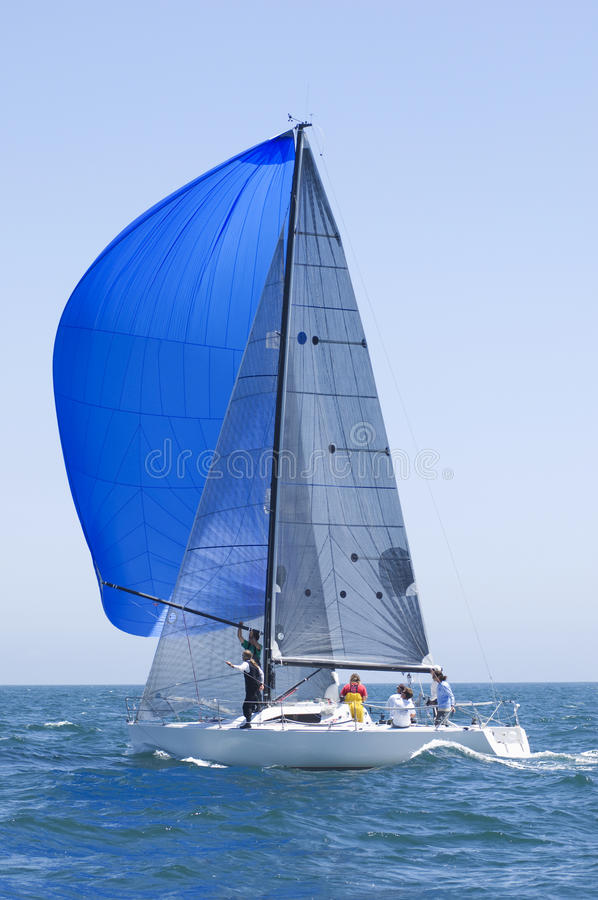 Yacht With Blue Sail Competes In Team Sailing Event royalty free stock photo
