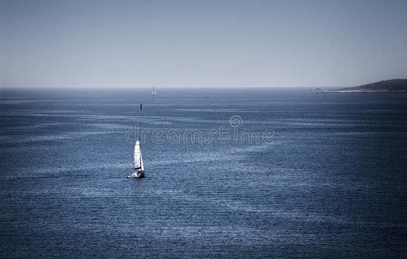 Yacht in blue sea stock photo
