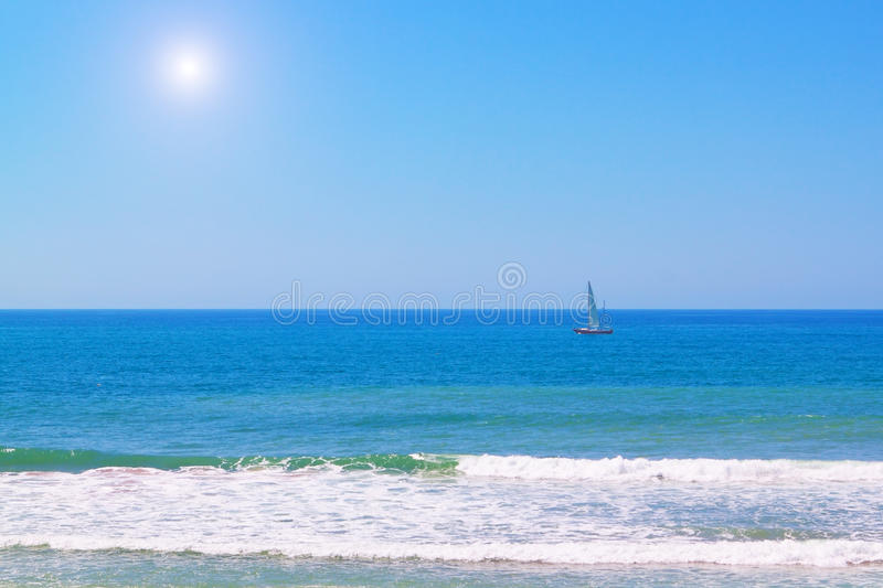 Yacht in the blue sea in the summer. stock photo