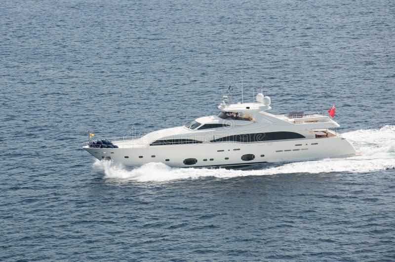 Yacht boat full speed. Cruising stock images