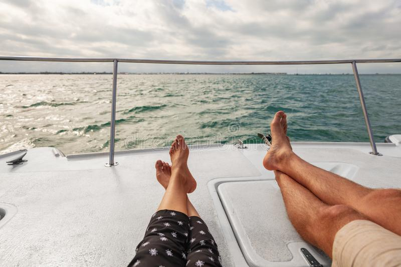 Yacht boat lifestyle couple relaxing on cruise ship in Hawaii holiday . Two tourists feet relax getaway enjoying vacation royalty free stock images