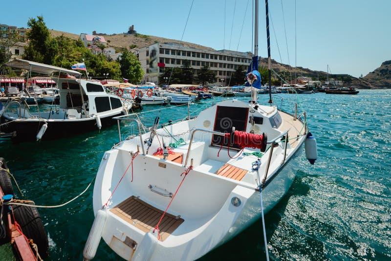 Yacht on the city promenade royalty free stock image
