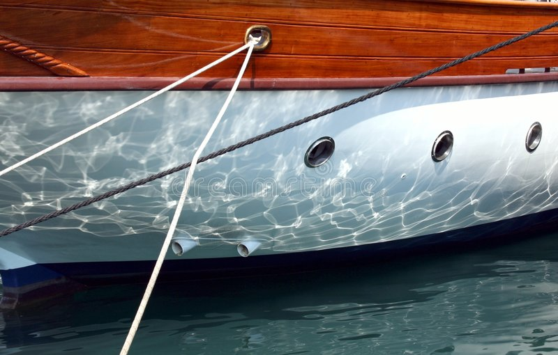 Yacht close -up. Yacht reflection in Aegean Sea stock image
