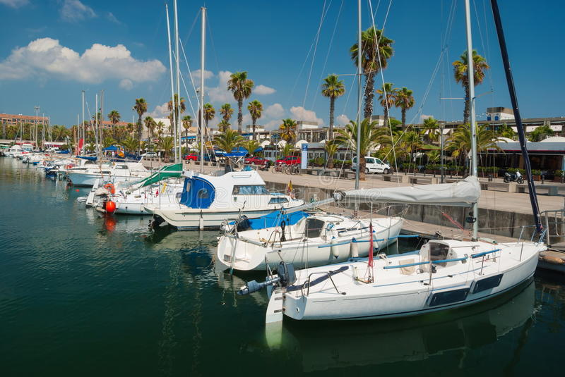 Yacht Club in Barcelona. Berth in Yacht Club with beautiful yachts in the bay in Barcelona royalty free stock image