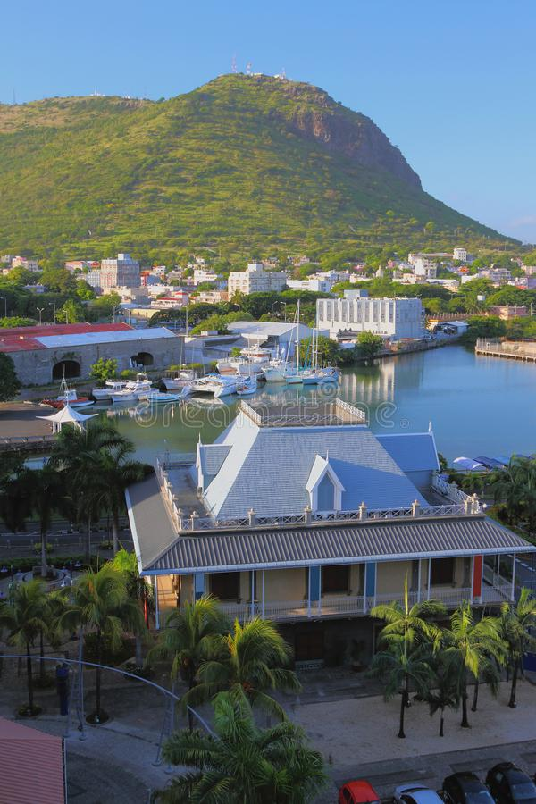 Yacht-club and city suburbs at mountain foot. Port Louis, Mauritius. Yacht-club and city suburbs at mountain foot in Port Louis, Mauritius; 09-01-2016 royalty free stock image