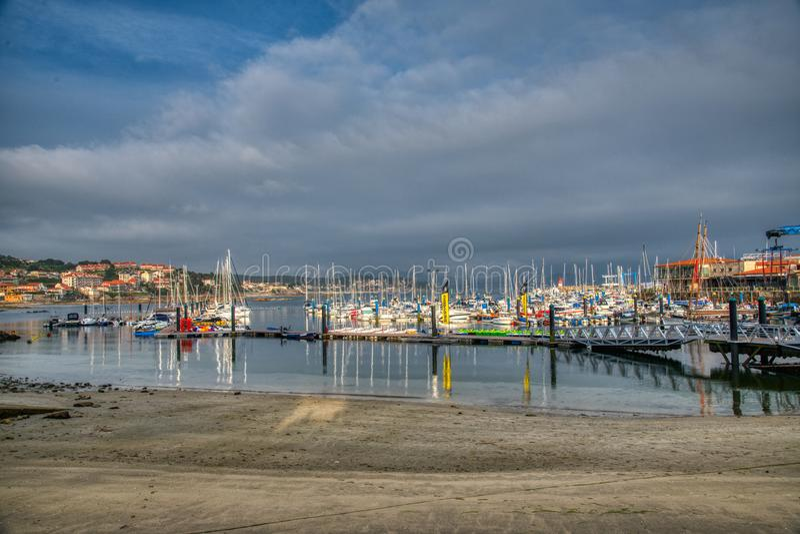 Yacht Club Portonovo, Galicia. Spain. Yacht Club Portonovo with a dramatic sky, Galicia. Spain royalty free stock images
