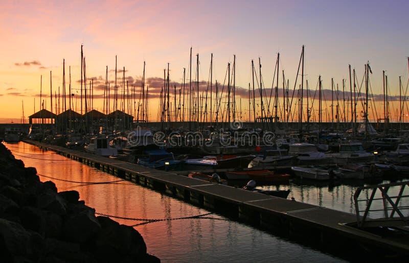 Yacht club in sunset. Marine in yacht club canary islands Gomera royalty free stock image