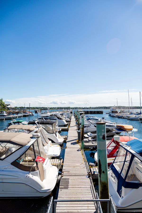 Yacht Dock into Distance. Fishing boats in harbor of Charlottetown, Prince Edward Island royalty free stock photo